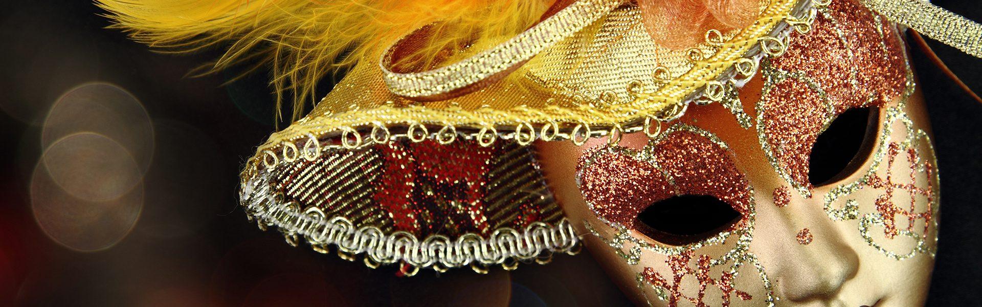17364304 - vintage carnival mask in front of lights background